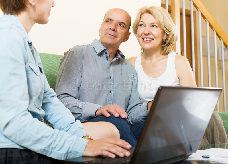 Mature couple listening female agent stock images