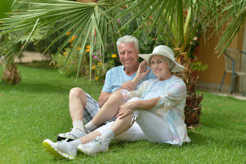 Mature couple in love. Travel, enjoy summer, posing outdoors royalty free stock image