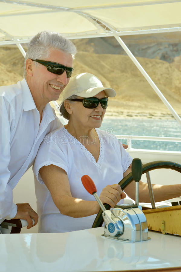 Mature couple in love. Travel, enjoy summer, posing outdoors royalty free stock photography