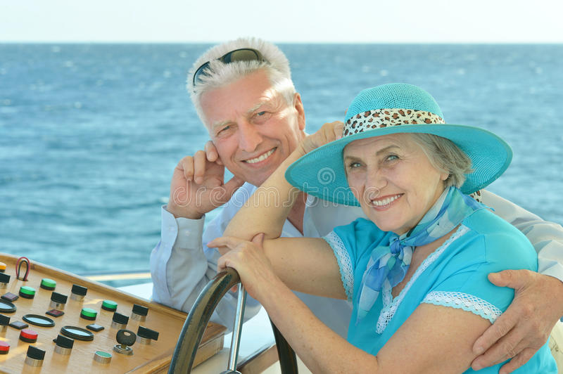 Mature couple in love. Travel, enjoy summer, posing outdoors royalty free stock images