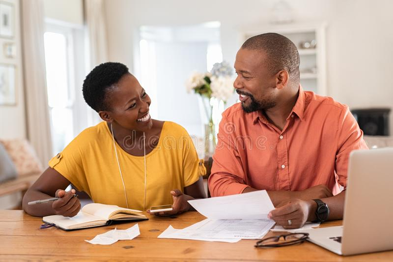 Mature couple managing home finance royalty free stock photography
