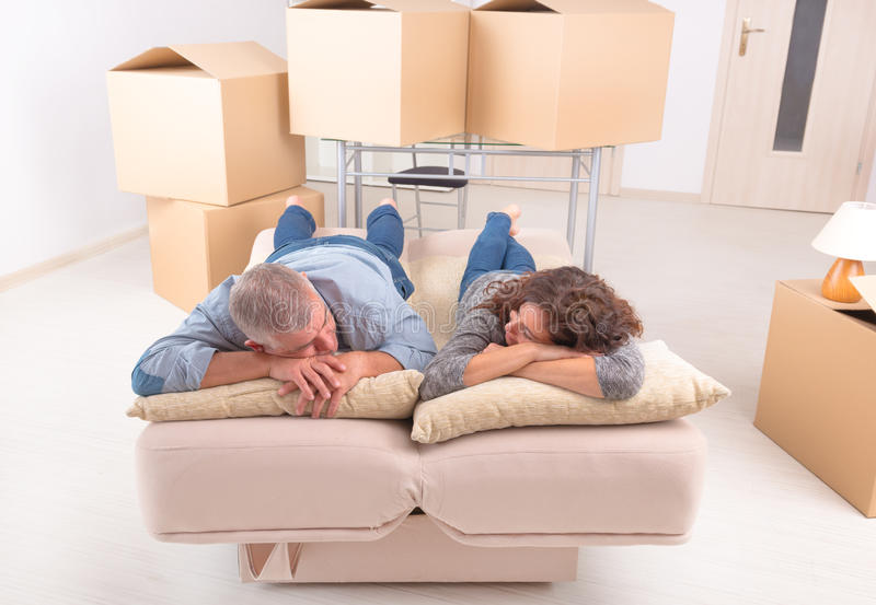 Mature couple at new home stock photography