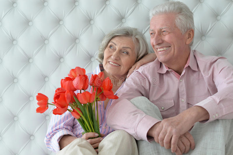 Mature couple with poppies stock photo