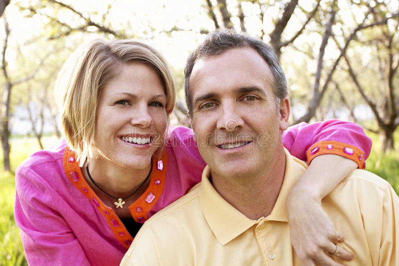 Mature Couple portrait. An attractive mature couple portrait outdoors royalty free stock photo