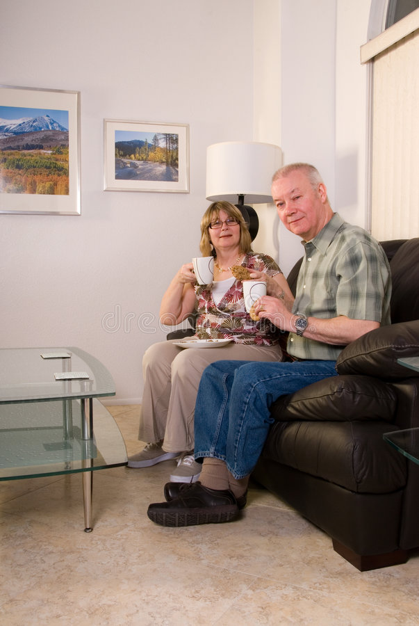 Mature couple relaxing at home stock photography