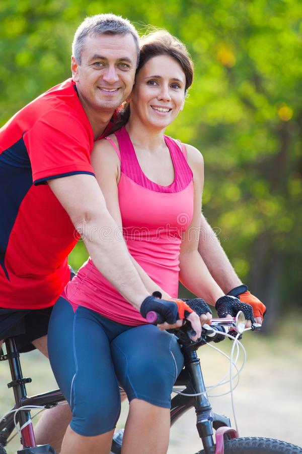 Mature Couple Riding  Bicycle Stock Photo