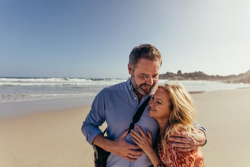Mature couple on romantic beach vacation royalty free stock photos
