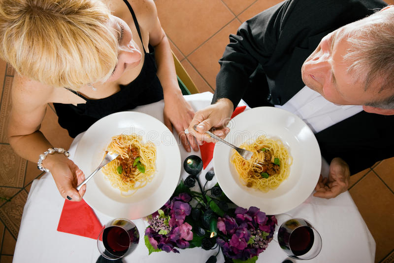 Mature Couple romantic dinner royalty free stock photo