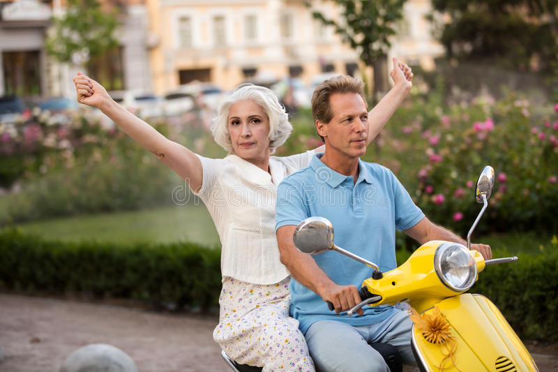 Mature couple on a scooter. royalty free stock image