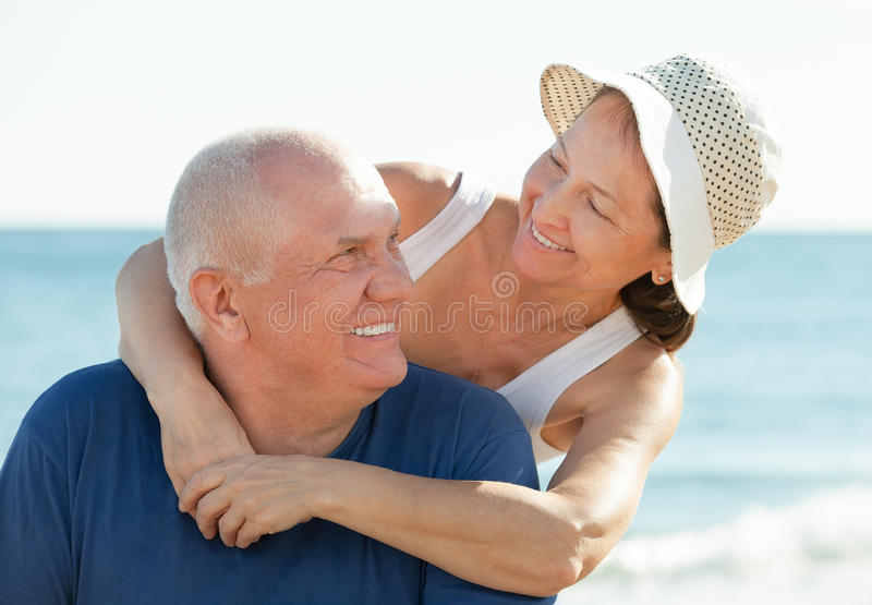 Mature couple at sea. Portrait of smiling mature couple at sea vacation royalty free stock photography