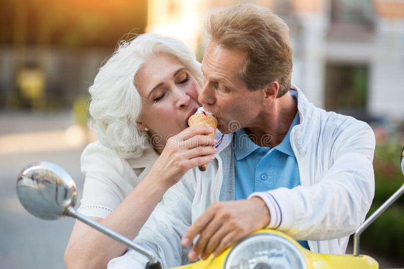 Mature couple shares ice cream. royalty free stock images