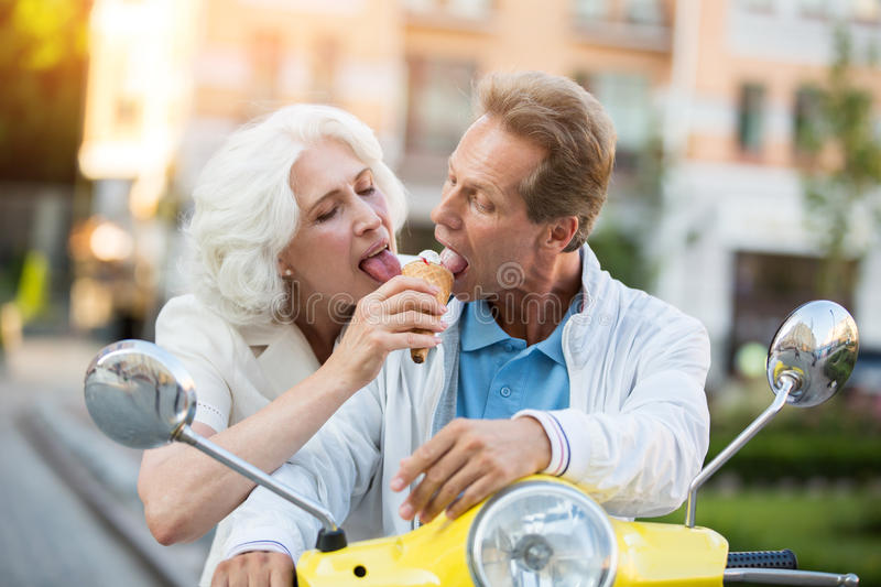 Mature couple sharing ice cream. royalty free stock images