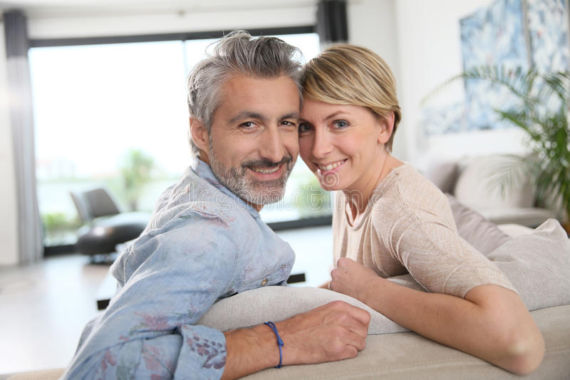 Mature couple sitting at home stock photography