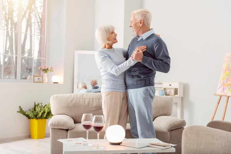 Mature couple smiling brightly to each other royalty free stock photo