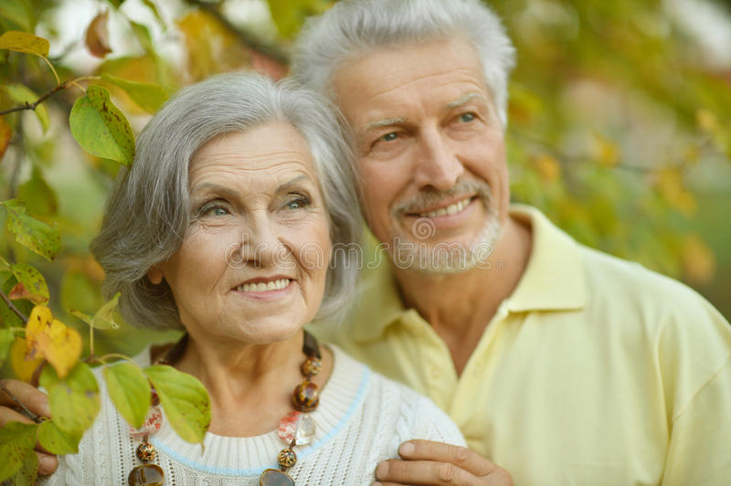 Mature couple in spring park. Nice mature couple in a spring park royalty free stock photography