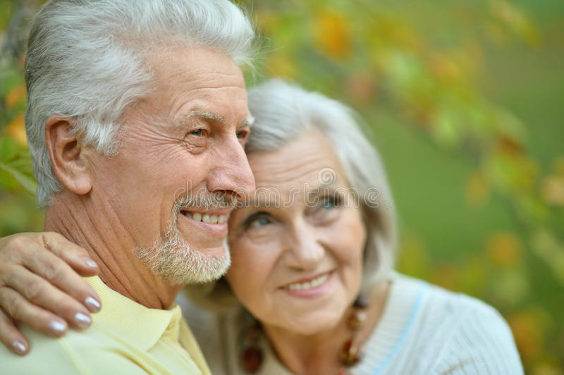 Mature couple in spring park. Nice mature couple in a spring park stock photos