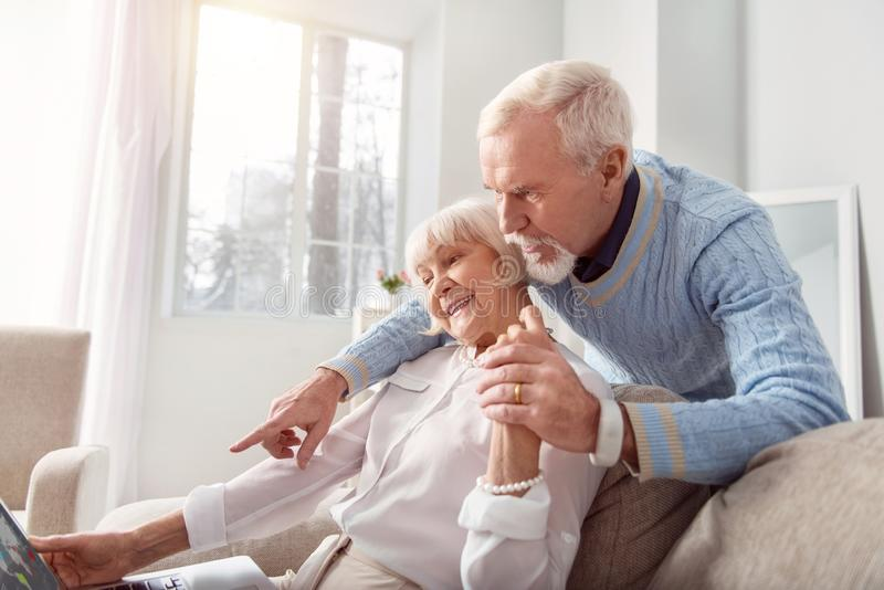 Mature couple surfing internet with a great interest stock photography