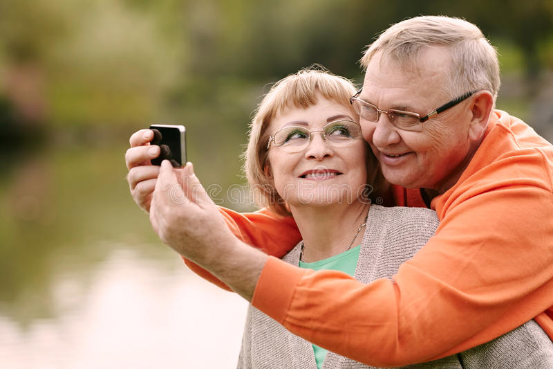 Mature couple taking selfie royalty free stock images