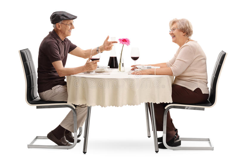 Mature couple talking on a date stock photos