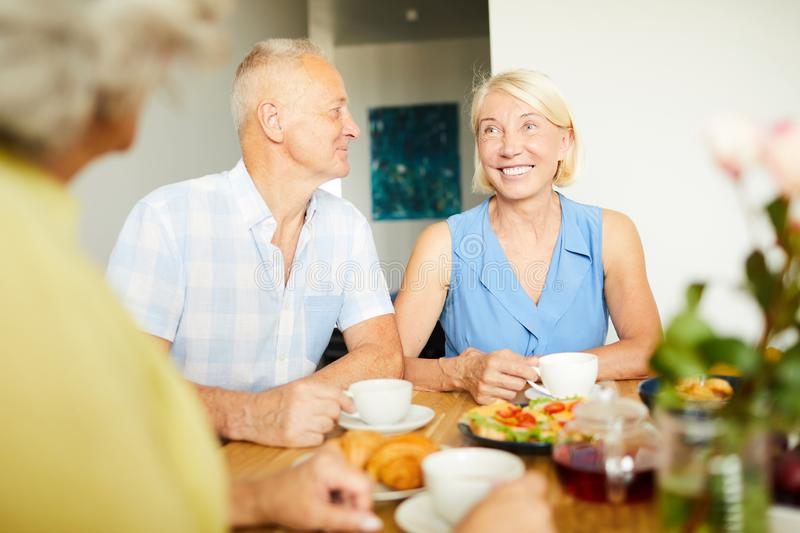 Mature Couple Talking to Friends royalty free stock photos