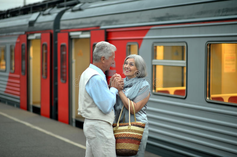 Mature couple at the train station royalty free stock photos