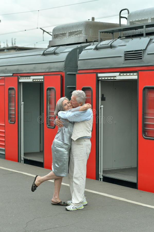Mature couple at the train station royalty free stock photo