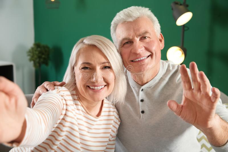 Mature couple using video chat at home, view from web camera royalty free stock photo