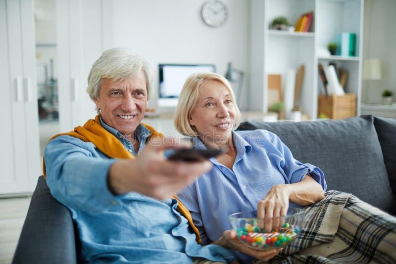Mature Couple watching TV stock photo
