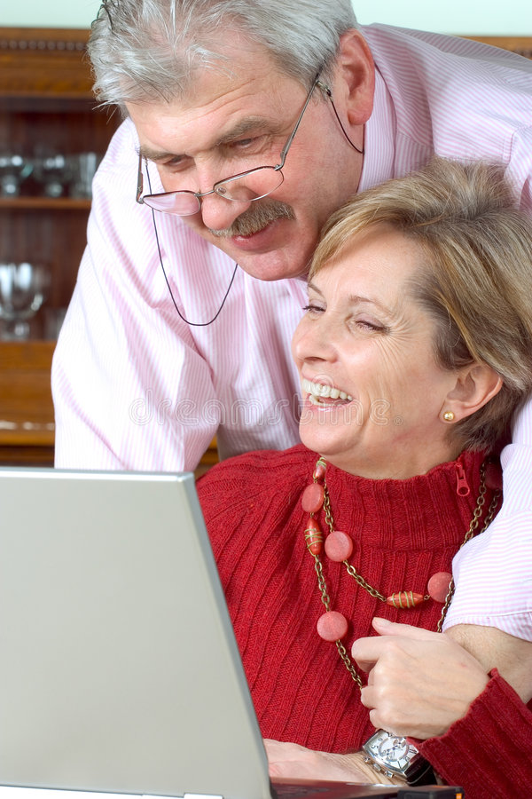 Mature couple working on lapto royalty free stock photo