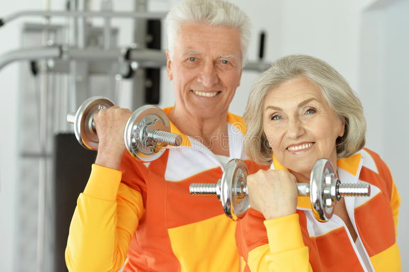 Mature couple working out. Portrait of a mature couple working out sport concept royalty free stock images