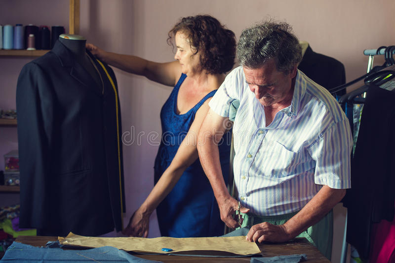 Mature couple working together. On a tailoring royalty free stock images