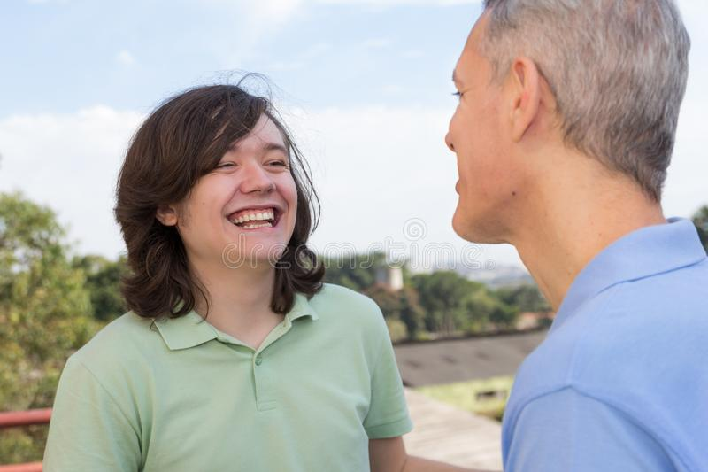 Mature dad and son. Fathers Day. Young male is laughing with par stock images