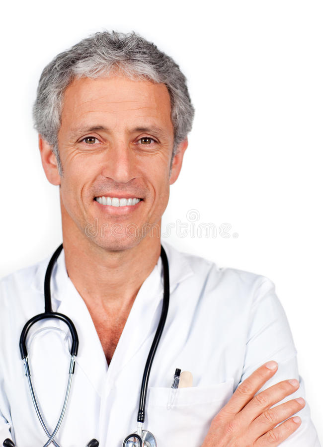 Mature doctor carrying a stethoscope stock photos