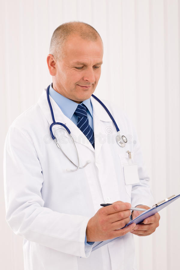 Free Mature Doctor Male Portrait Write Document Royalty Free Stock Photos - 21943008