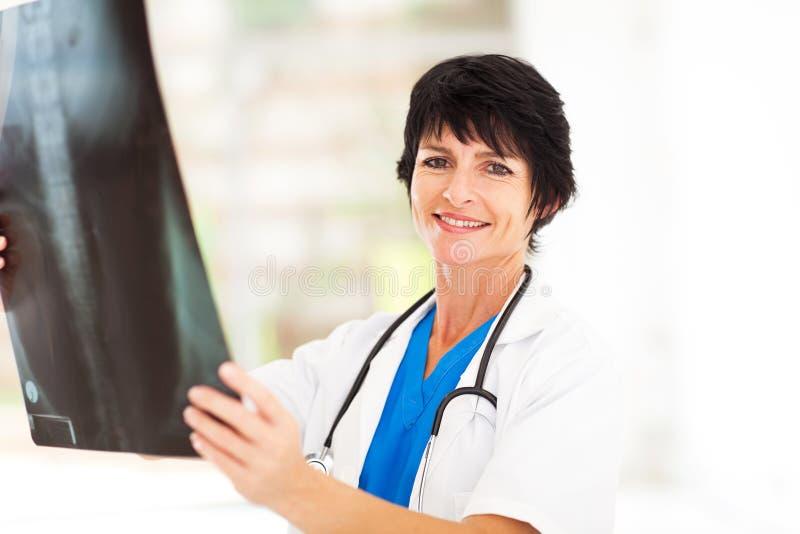 Mature doctor x-ray stock photos