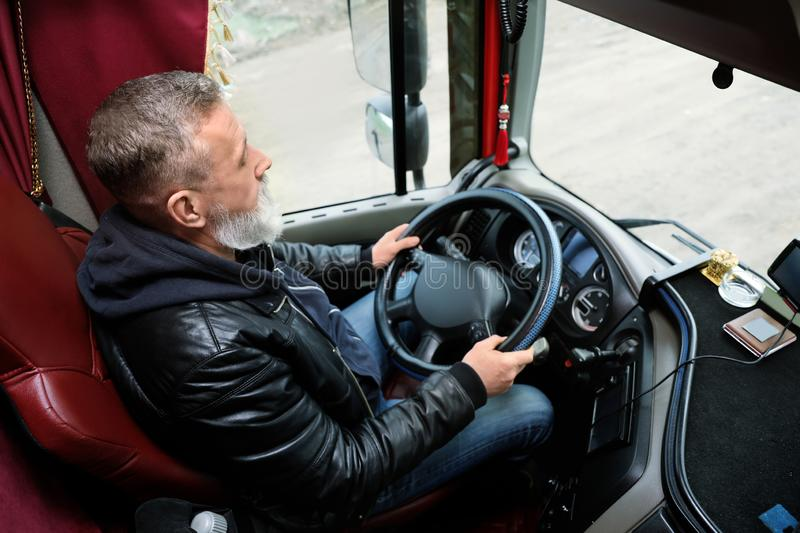 Mature driver sitting in cab of truck. Mature driver sitting in cab of modern truck royalty free stock image