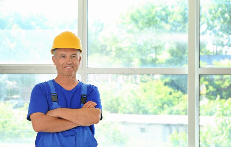 Mature electrician in new flat stock images
