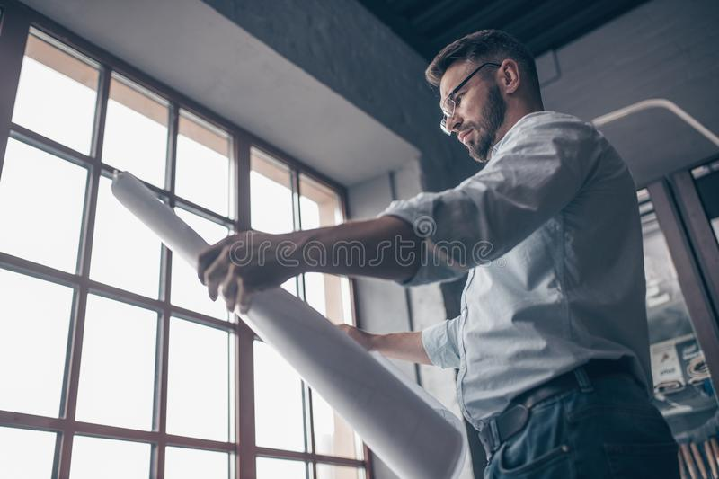 Mature engineer with a drawing royalty free stock images