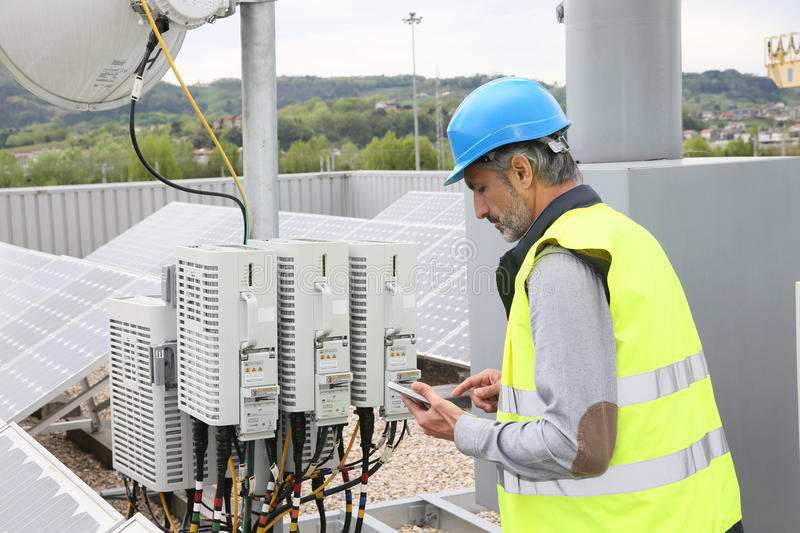 Mature engineer working on installations stock photo