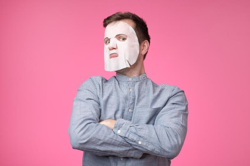 Mature european man in a cosmetic mask for skin care royalty free stock images