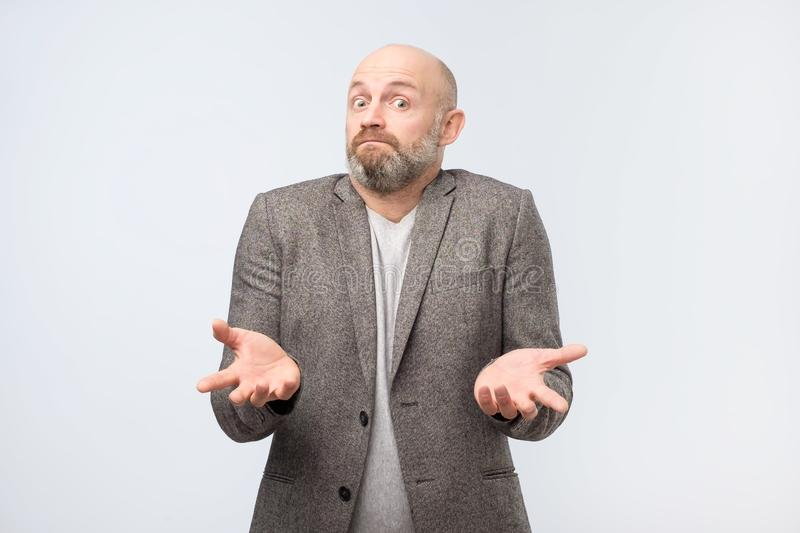 Mature european man does not know what to do. royalty free stock photography