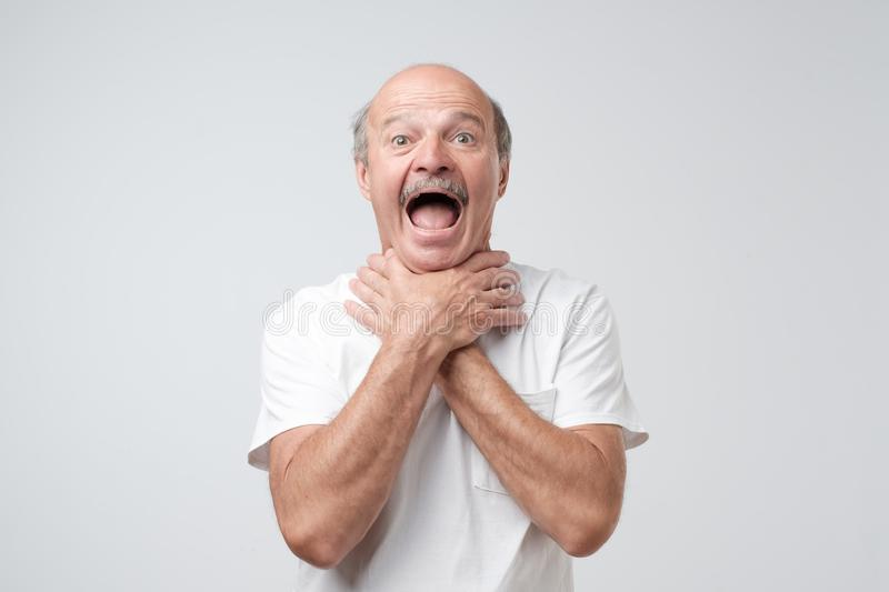 Mature European Man In White Tshirt Shouting And Suffocate Because Painful  Strangle. Health Problem. Stock Image - Image of hold, male: 123418759