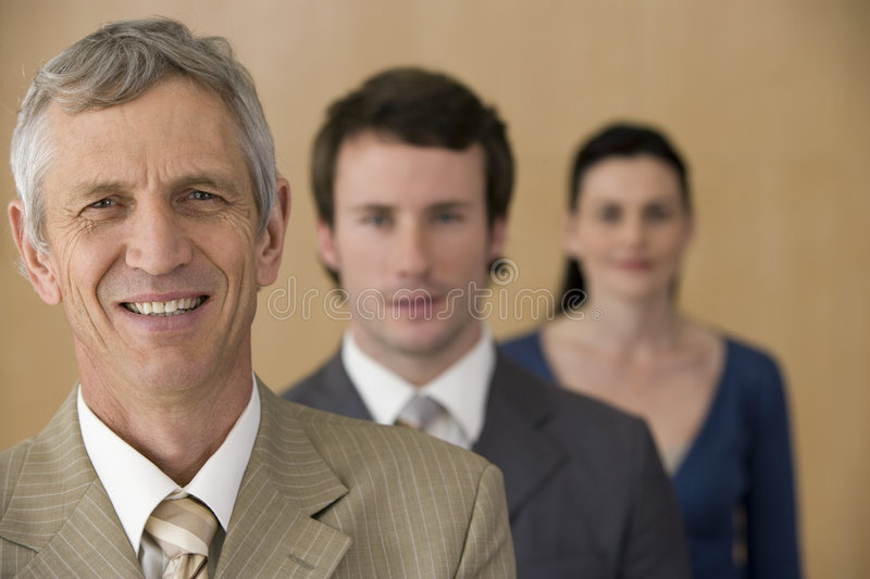 Mature executive with team stock image