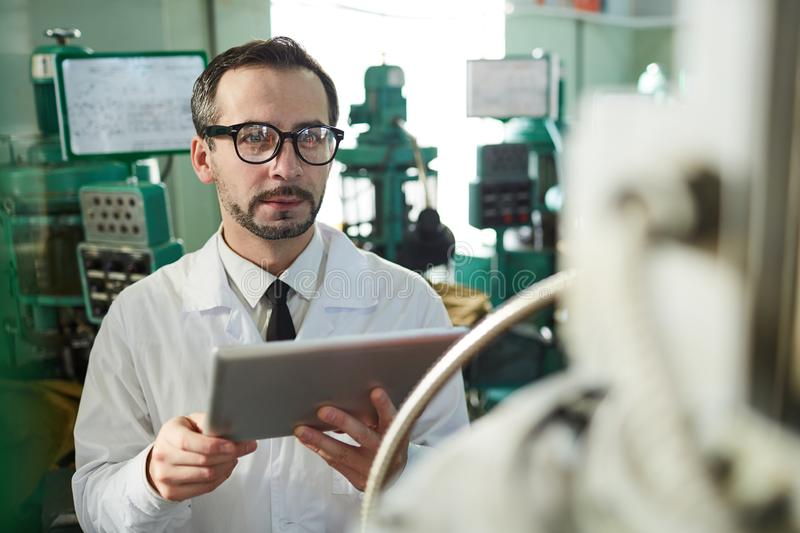 Mature Factory Worker Using Tablet stock photos
