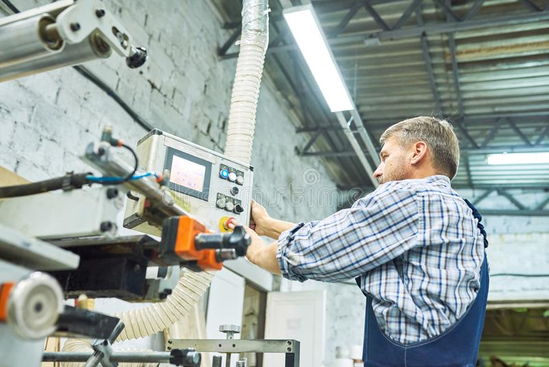 Mature Factory Workers Operating Machines stock photo