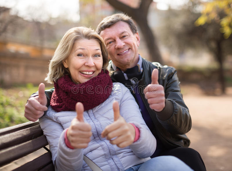 Mature family couple staying outdoor royalty free stock photography