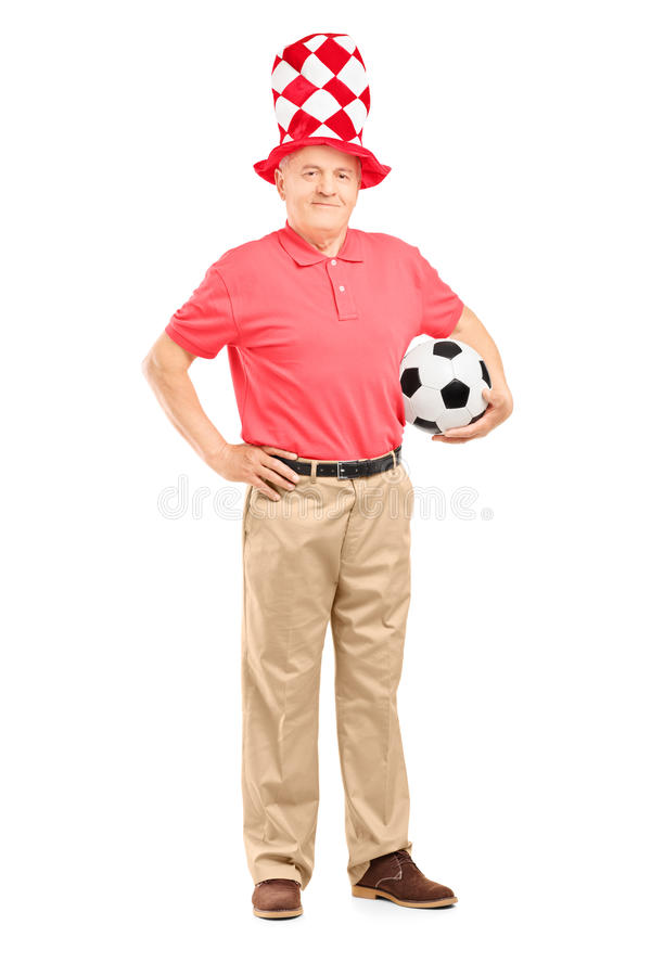 Mature fan with hat holding a soccer ball