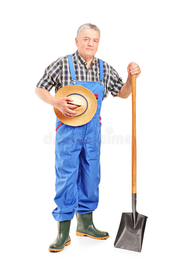 Mature Farmer Holding A Shovel Royalty Free Stock Photos