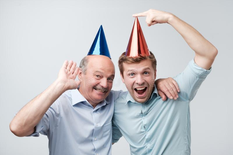 father and son celebrating birthday or other family holiday. They are happy to see their guests stock photos