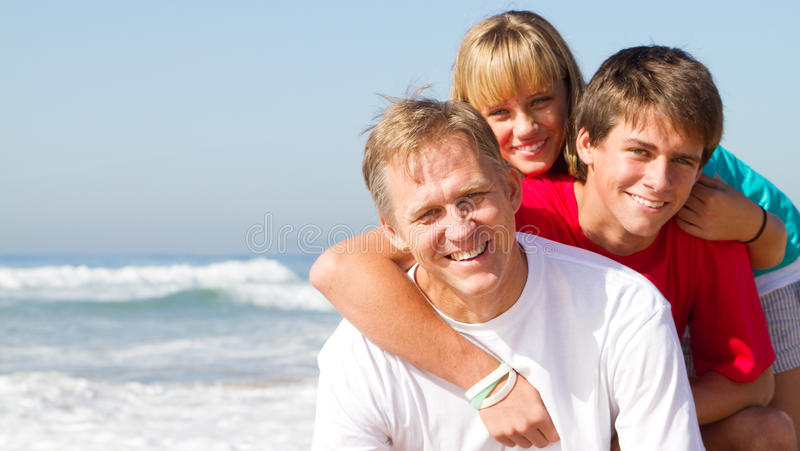 Mature Father And Teen Kids Royalty Free Stock Image